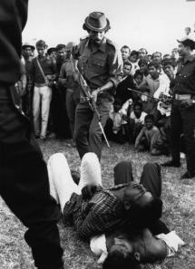 Torturing unarmed pro Pakistanis